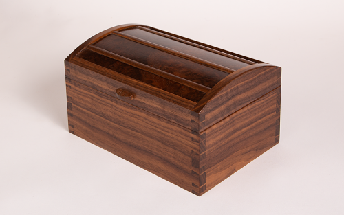 Curved lid jewellery box in walnut with burr walnut lid panels
